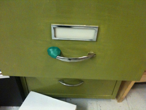 Re-attach a filing cabinet handle
