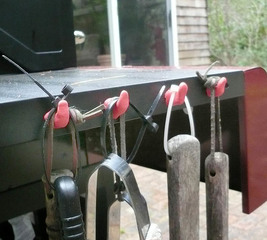 Make tool hooks for an outdoor grill
