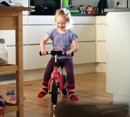Prevent a kid's bike from scratching the floor