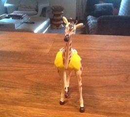 Fix a leg on a toy giraffe