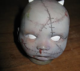Spookify a Halloween doll's head