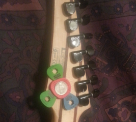 Add a 3 pick holder to a guitar