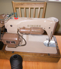 Modify a sewing machine for a larger reel of thread